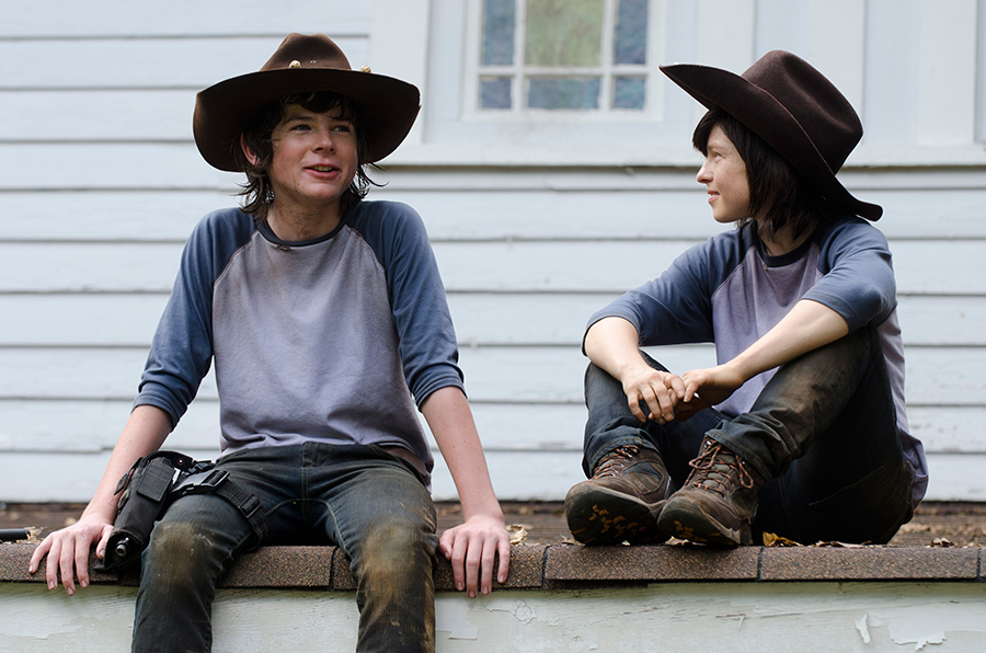 "Chandler Riggs with his stunt double on the set of AMC's ""The Walking Dead."""