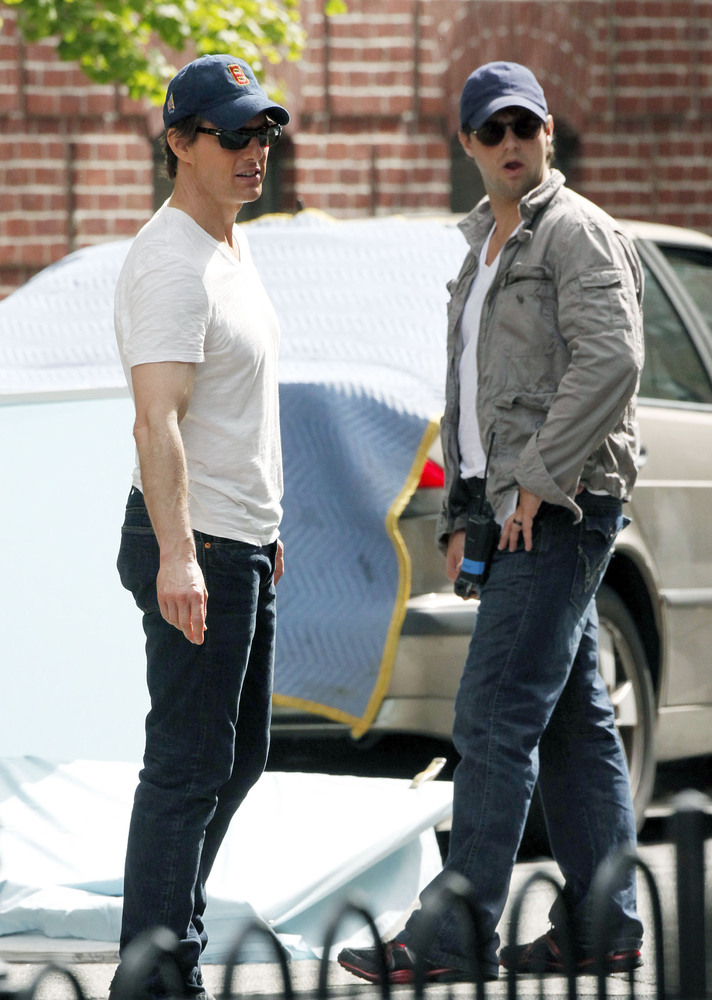 "Tom Cruise, left, with his stunt double on the set of ""Knight and Day."""