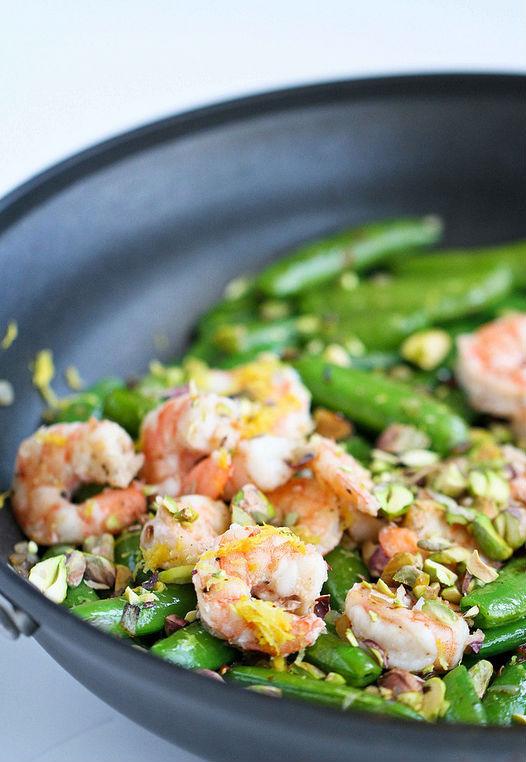 "<strong>Get the <a href=""http://www.cookincanuck.com/2013/03/sauteed-shrimp-snap-peas-pistachio-basil-recipe/"" target=""_blank"