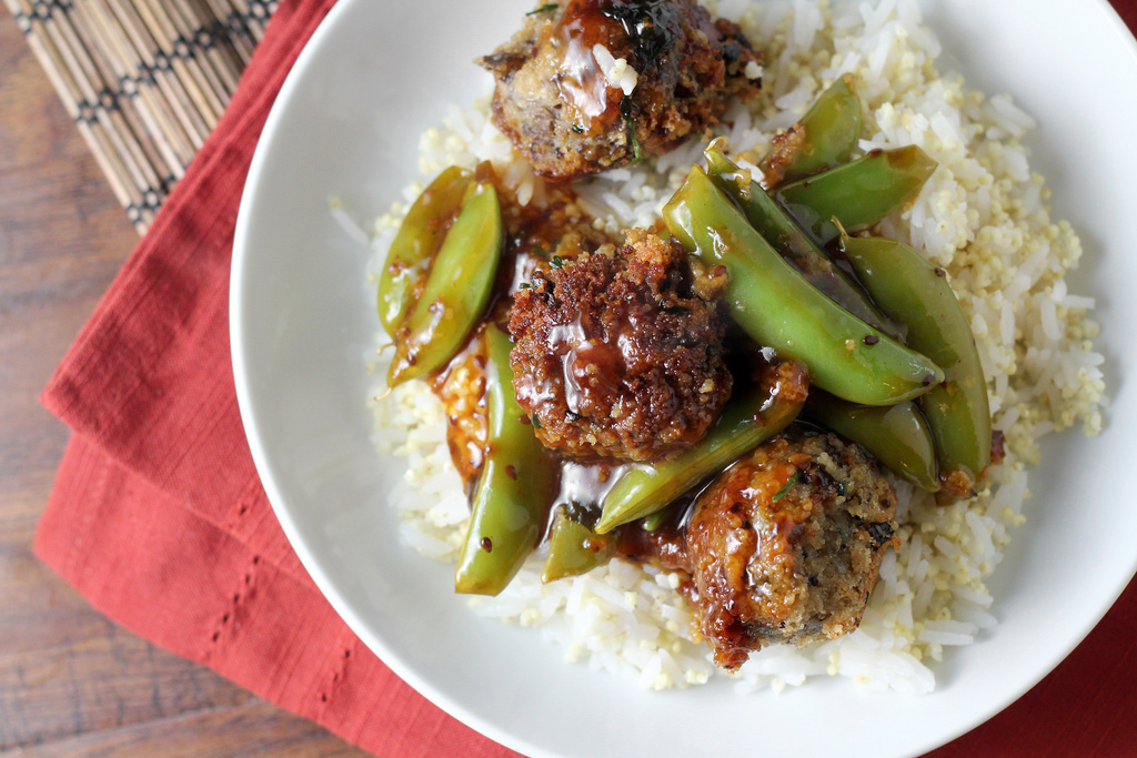 """<strong>Get the <a href=""""http://joanne-eatswellwithothers.com/2013/11/eggplant-meatballs-and-sugar-snap-peas-in-a-toasted-ses"""