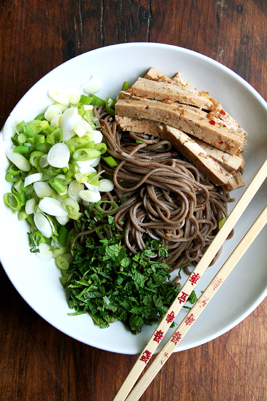 """<strong>Get the <a href=""""http://www.alexandracooks.com/2013/05/15/soba-salad-with-marinated-tofu-mint-scallions/"""" target=""""_bl"""
