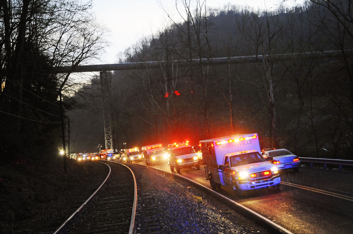 In a Monday, April 5, 2010 file photo, emergency vehicles leave the entrance to Massey Energy's Upper Big Branch Coal Mine in