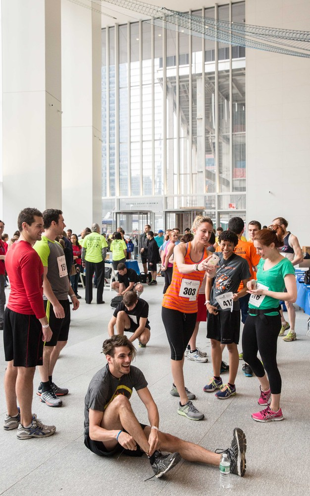 Runners prepare in the lobby of 4 World Trade Center