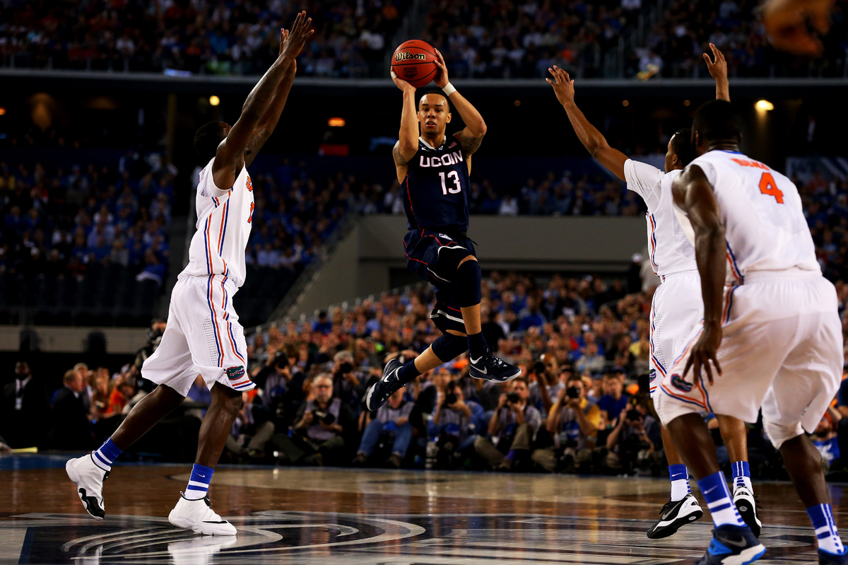 ARLINGTON, TX - APRIL 05: Shabazz Napier #13 of the Connecticut Huskies looks to pass against the Florida Gators during the N