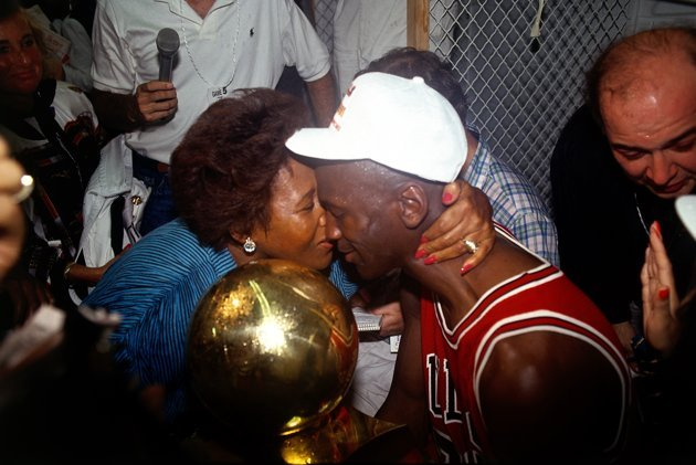 Michael Jordan embraces his mother after the Chicago Bulls won the 1991 NBA Championship against the Los Angeles Lakers.  <em