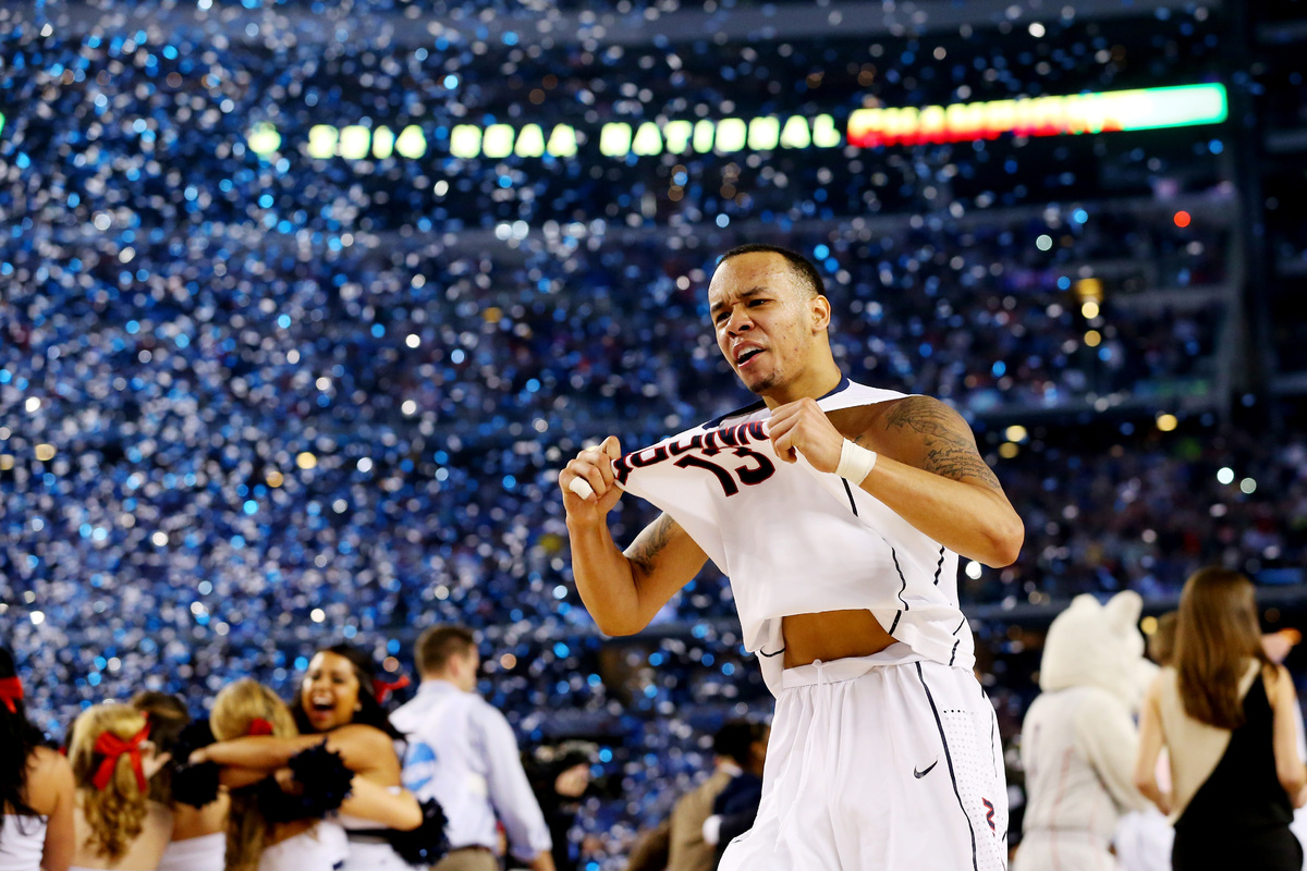 ARLINGTON, TX - APRIL 07:  Shabazz Napier #13 of the Connecticut Huskies celebrates on the court after defeating the Kentucky