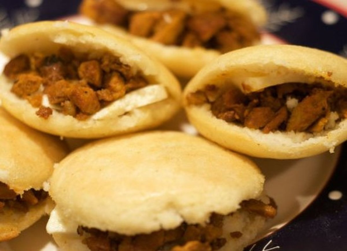 Arepa technically refers to a delicious, chewy, crispy, maize-dough flatbread sandwiches filled with pretty much anything you