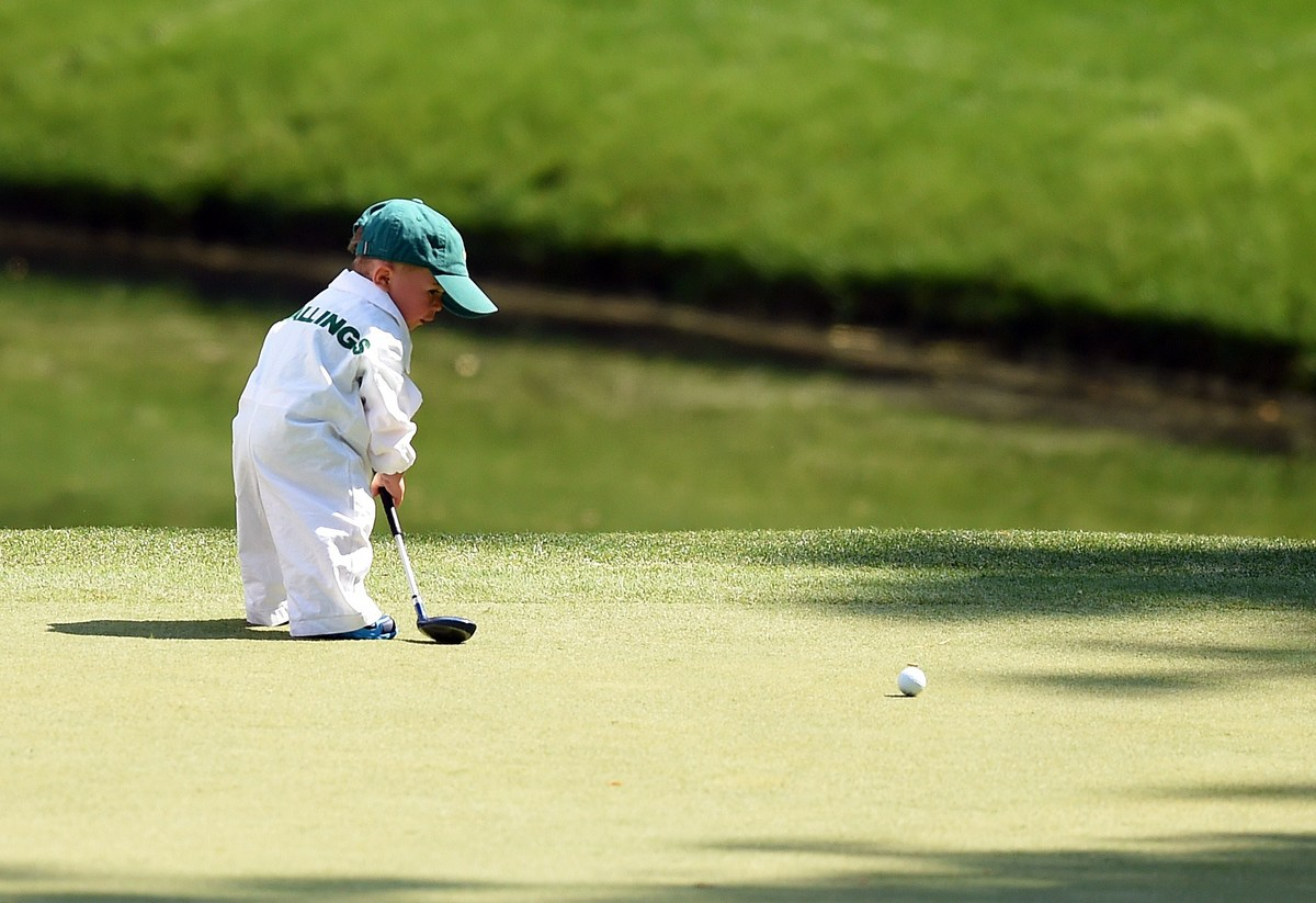 Finn, son of Scott Stallings, plays during the Par 3 Contest at Augusta National Golf Club on April 9, 2014 in Augusta, Georg