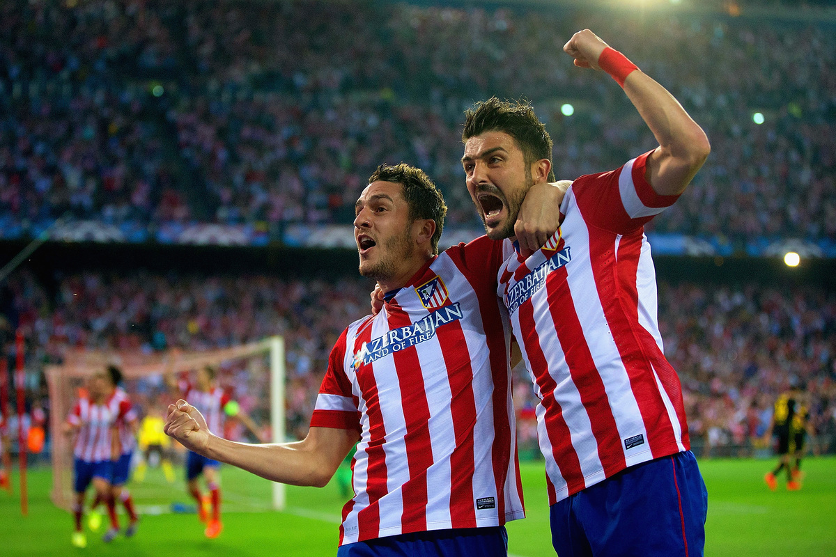 MADRID, SPAIN - APRIL 09:  Koke of Club Atletico de Madrid celebrates scoring the opening goal with David Villa of Club Atlet