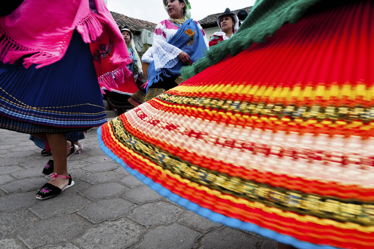 Young girls, wearing colorful skirts, dance in a procession during the Inti Raymi fiesta on 26 June 2010 in the village of Ol