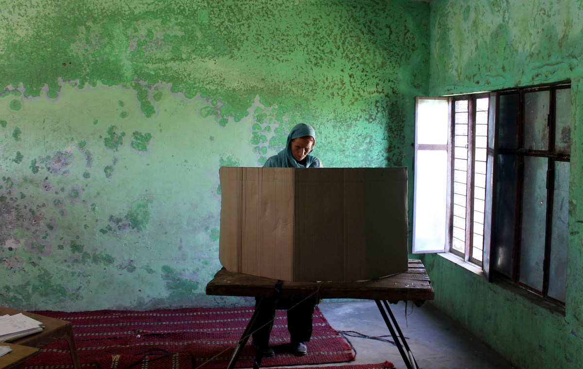 An Indian voter casts her ballot at a polling booth at Bajalta village near Jammu, on April 10, 2014, during national electio