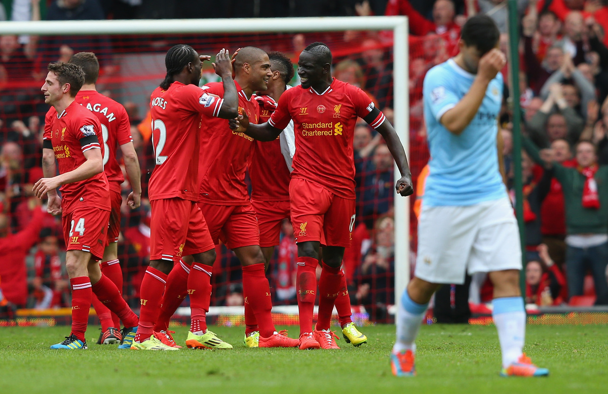 LIVERPOOL, ENGLAND - APRIL 13:  The Liverpool players celebrate at the end of the Barclays Premier League match between Liver