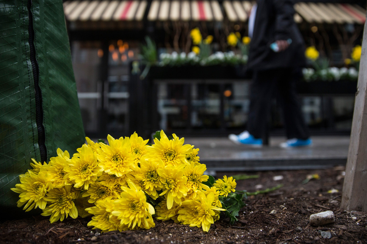 Flowers lie on the finish line of the Boston Marathon on the one-year anniversary of the bombing.