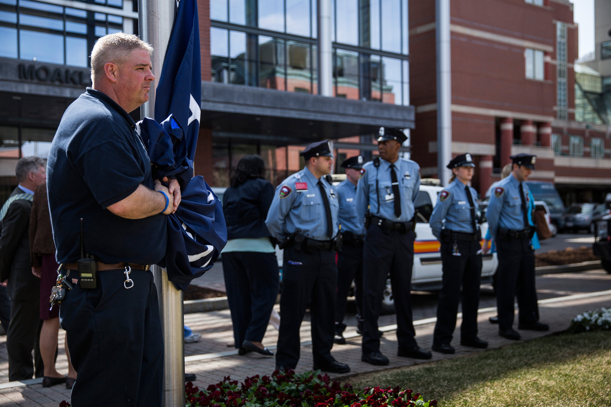 BOSTON, MA - APRIL 14:  Michael Burns waits to unveil a 'Boston Medical Center Strong' flag during a flag raising ceremony at