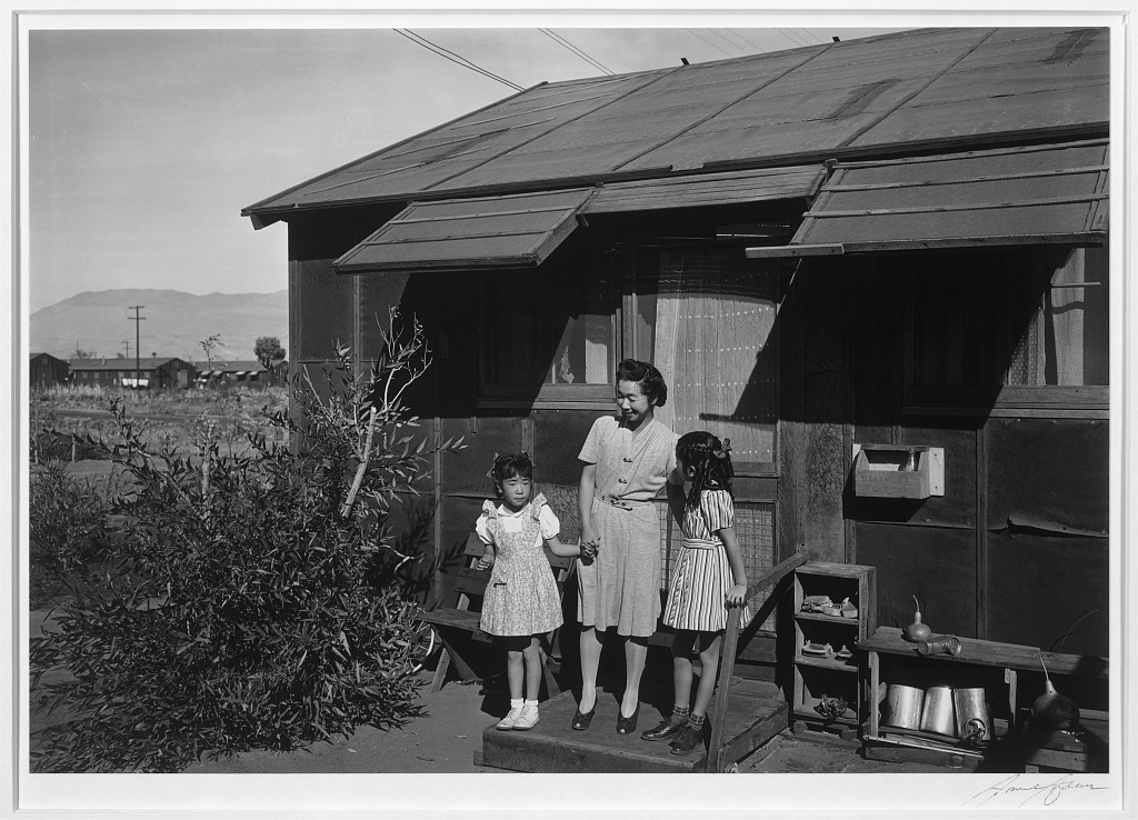 "<a href=""http://www.anseladams.com/the-girls-of-manzanar/"" target=""_blank"">Mrs. Nakamura And Her Daughters</a>"