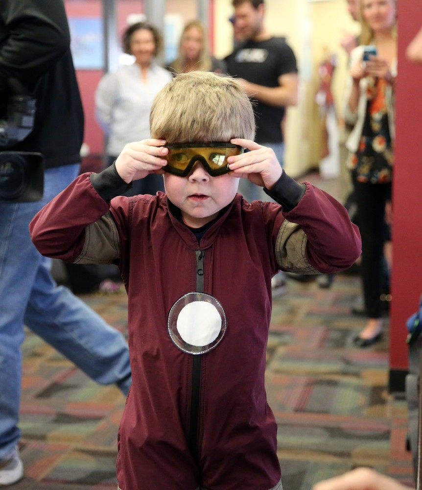 Wearing an Iron Man costume, Max Vertin, 8, from Hastings, Neb., adjusts his goggles as he prepares to float in a wind tunnel