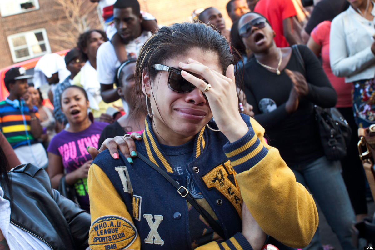 NEW YORK, NY - MARCH 22:  A woman cries during a vigil for Ramarley Graham outside New York City Police Department's 47th Pre