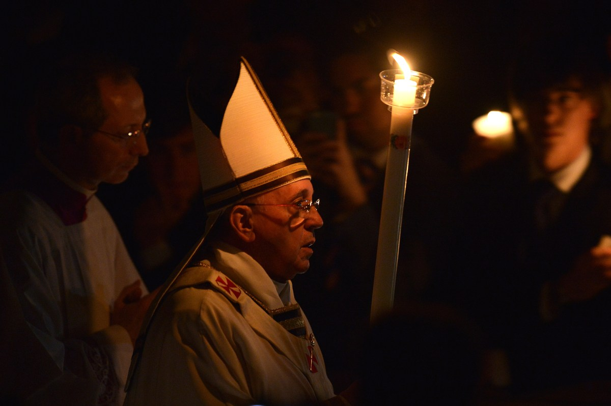 Pope Francis holds a candle during the Easter Vigil at the St Peter basilica in Vatican. Easter Vigil, also called the Pascha