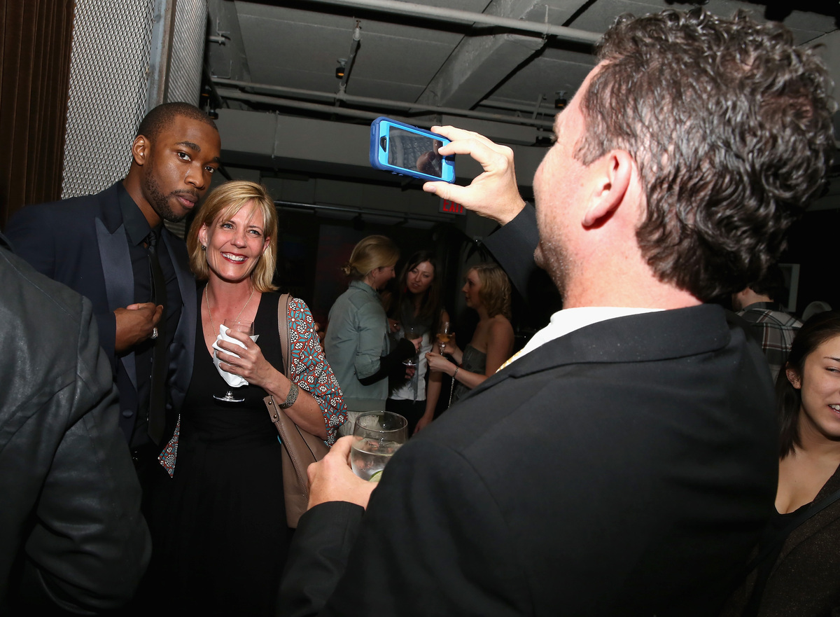 """Jay Pharoah poses with guests at the """"Intramural"""" premiere after party during the 2014 Tribeca Film Festival at Neuehouse on"""