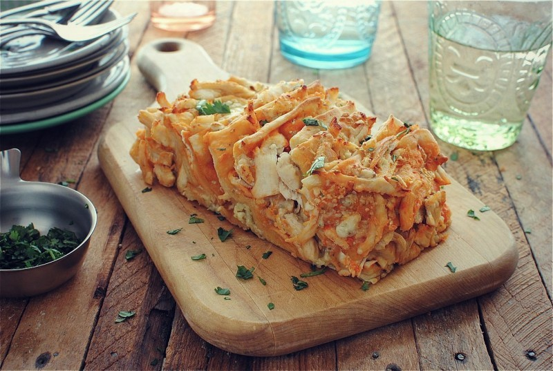 """<strong>Get the <a href=""""http://bevcooks.com/2012/10/buffalo-chicken-pull-apart-bread/"""">Buffalo Chicken Pull-Apart Bread reci"""