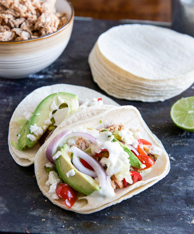 """<strong>Get the <a href=""""http://www.howsweeteats.com/2013/03/smokey-roasted-chicken-tacos-with-spicy-goat-cheese-queso/"""" targ"""