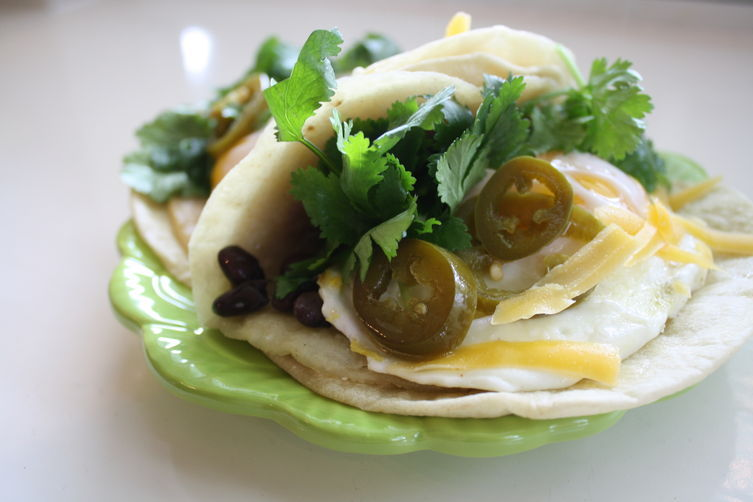"<strong>Get the <a href=""http://food52.com/recipes/27333-the-ultimate-fried-egg-breakfast-tacos"" target=""_blank"">Ultimate Fri"