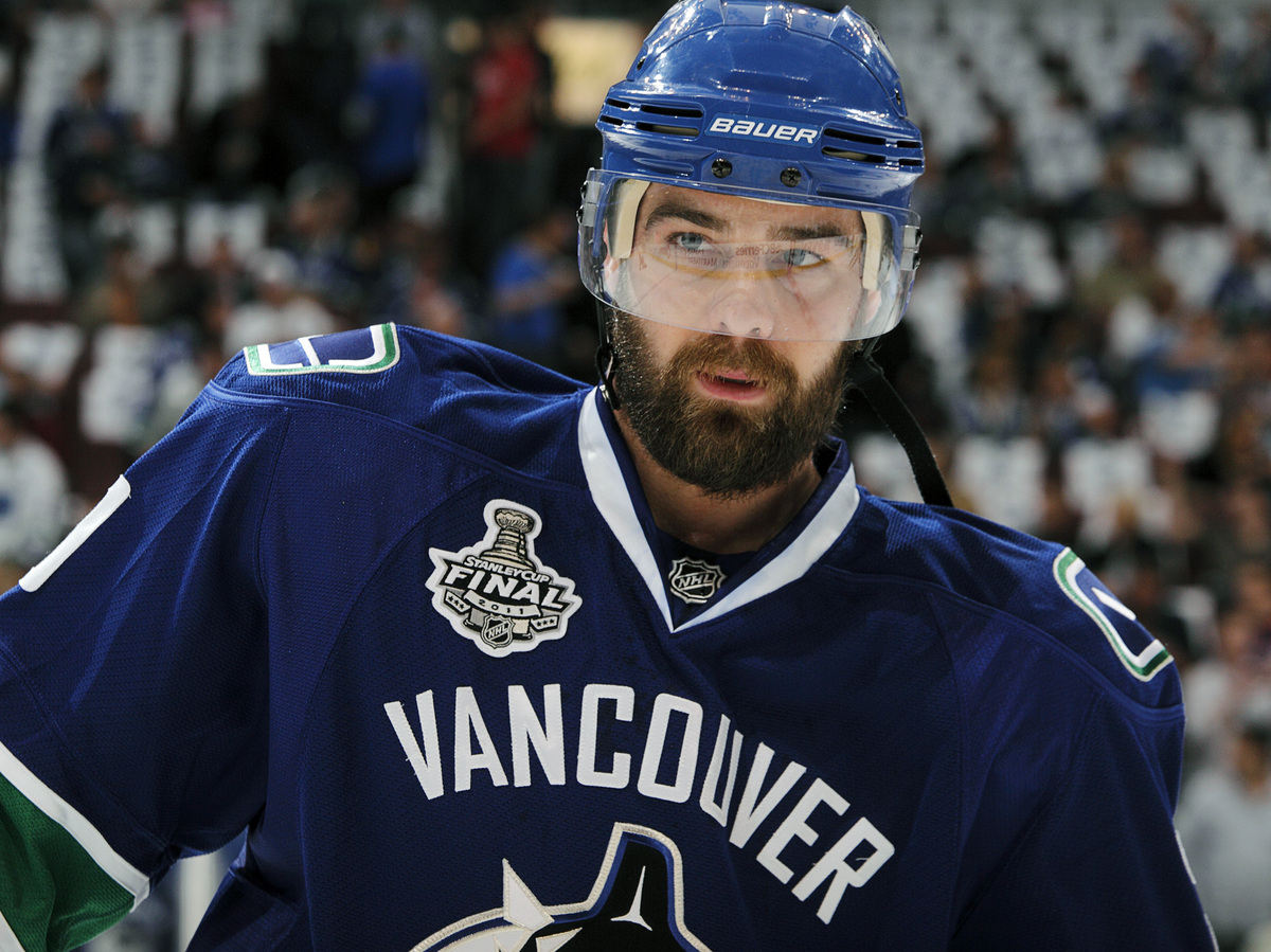 "Chris Higgins grew this impressively full beard during the 2011 playoffs. His <a href=""http://canucks.nhl.com/"" target=""_blan"