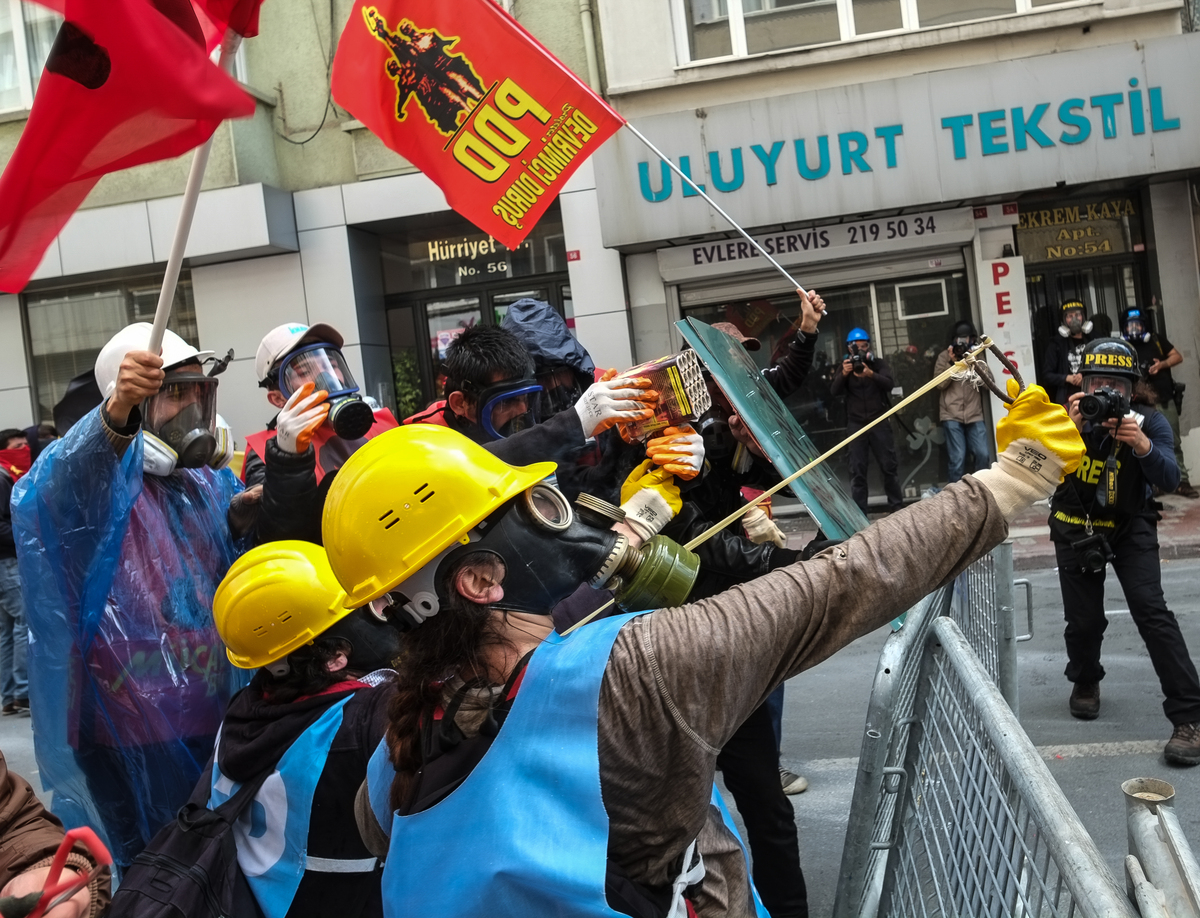 Turkish riot police use water cannon and tear gas to disperse protesters during a May Day demonstration on May 1, 2014 in Ist