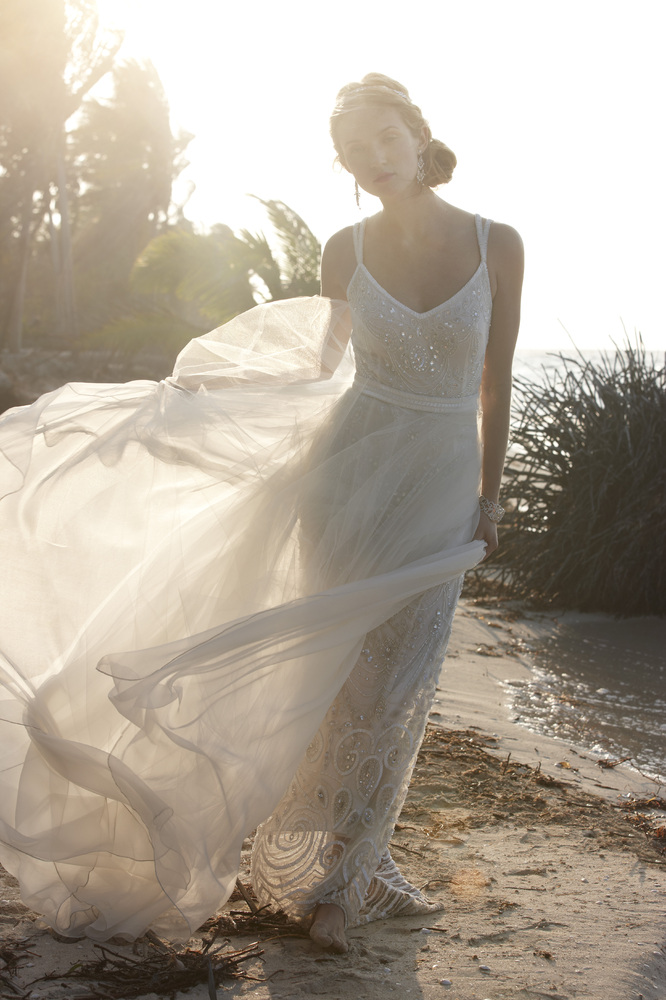 <em>Elsa beaded gown and tulle skirt from Theia Bridal. Gown, $1,495; detachable skirt, $595.</em>