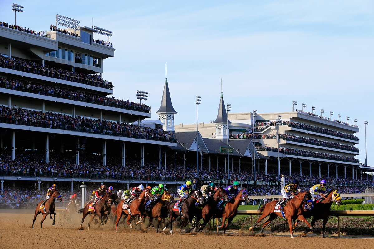 LOUISVILLE, KY - MAY 03: The field heads out of the first turn during the 140th running of the Kentucky Derby at Churchill Do