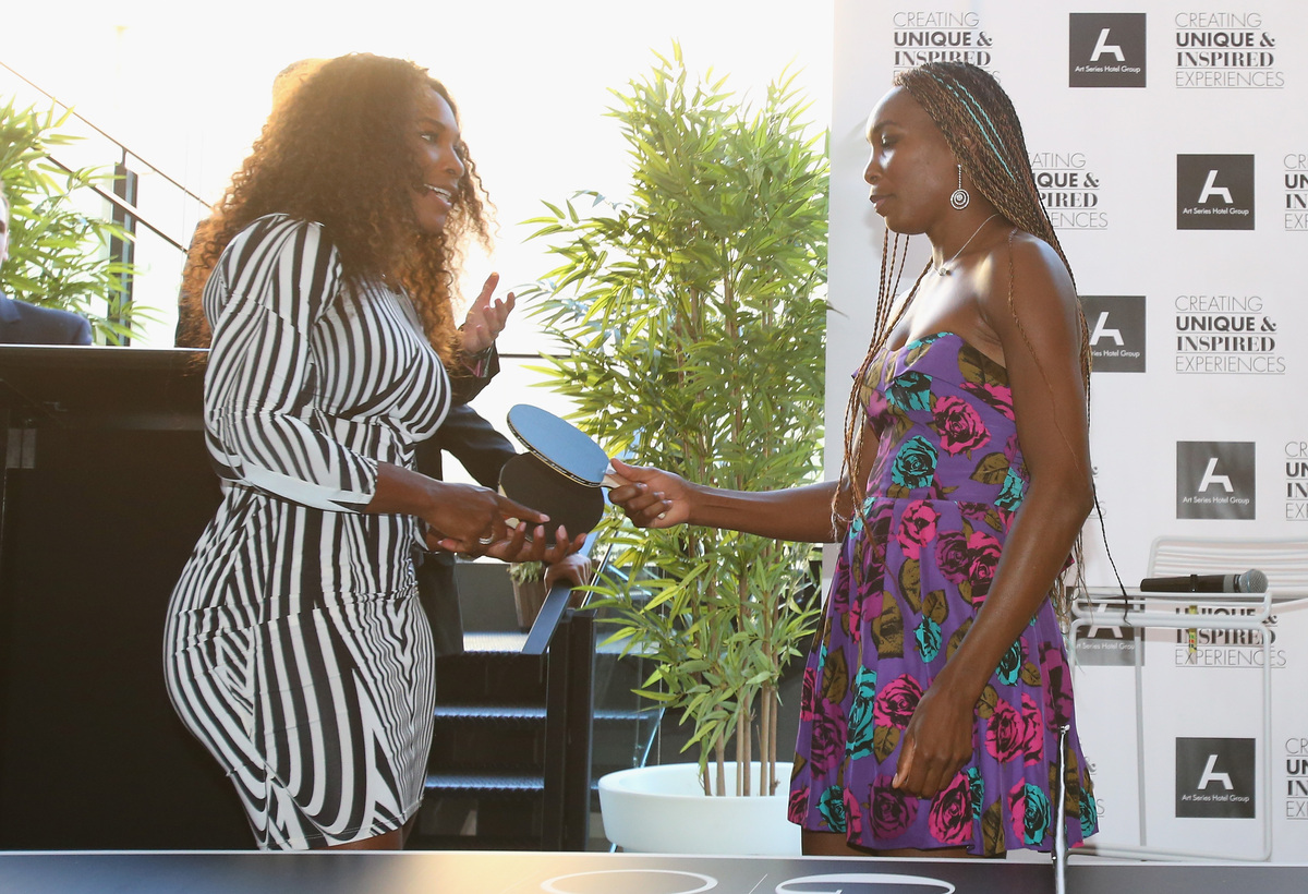 MELBOURNE, AUSTRALIA - JANUARY 10:  Serena Williams (L) and her sister Venus Williams prepare to play table tennis at a 'Welc