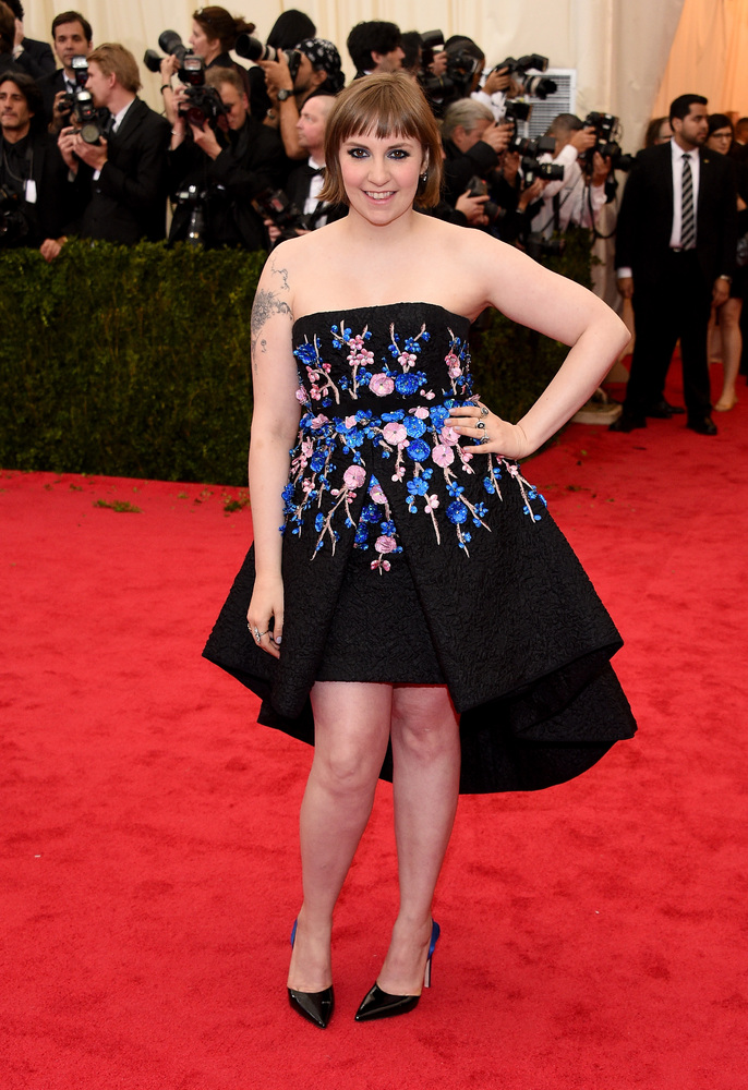 Lena, no! This dress is hardly flattering. We wish she would choose something besides a strapless neckline and a mullet hemli