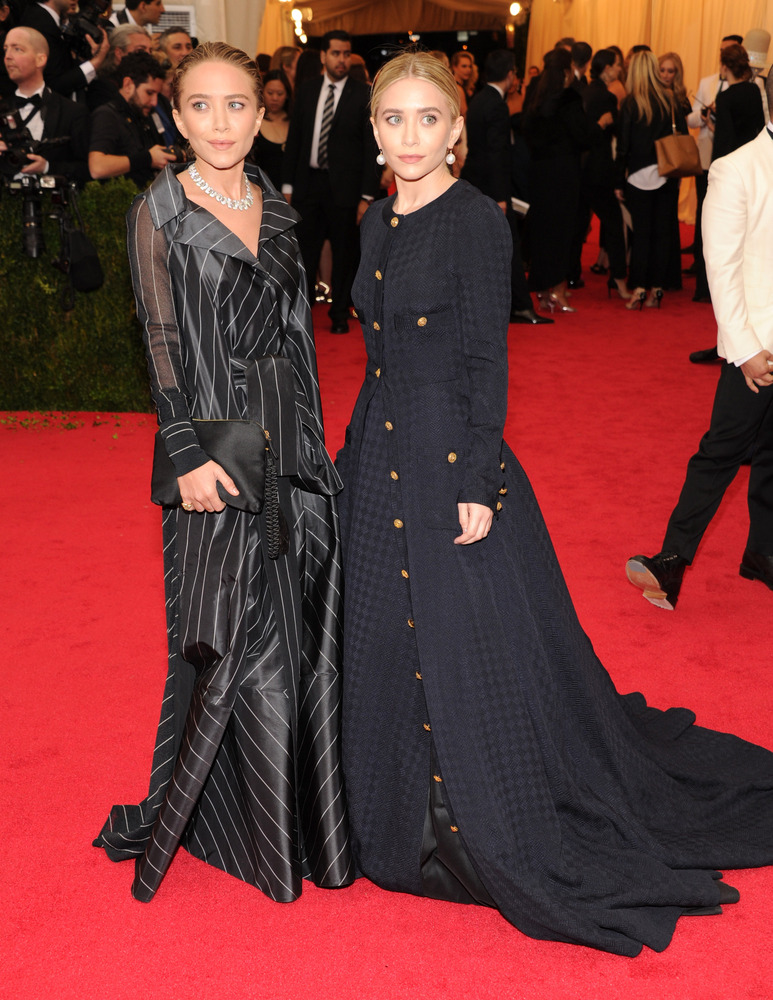It pains us to put the Olsens on this list, but the twins are literally drowning in their dresses.