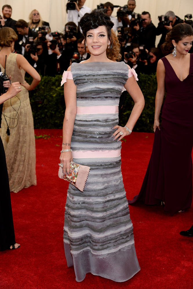 The silhouette of this dress and the grey stripes just aren't working. If this dress had a more plunging neckline or a shorte