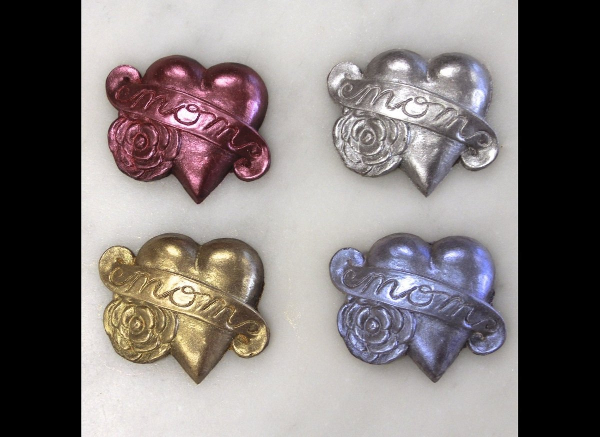 """<a href=""""http://almachocolate.com/products/icons/mom-tattoo-heart """" target=""""_hplink""""><strong>Alma """"Mom"""" Heart-Shaped Chocolat"""