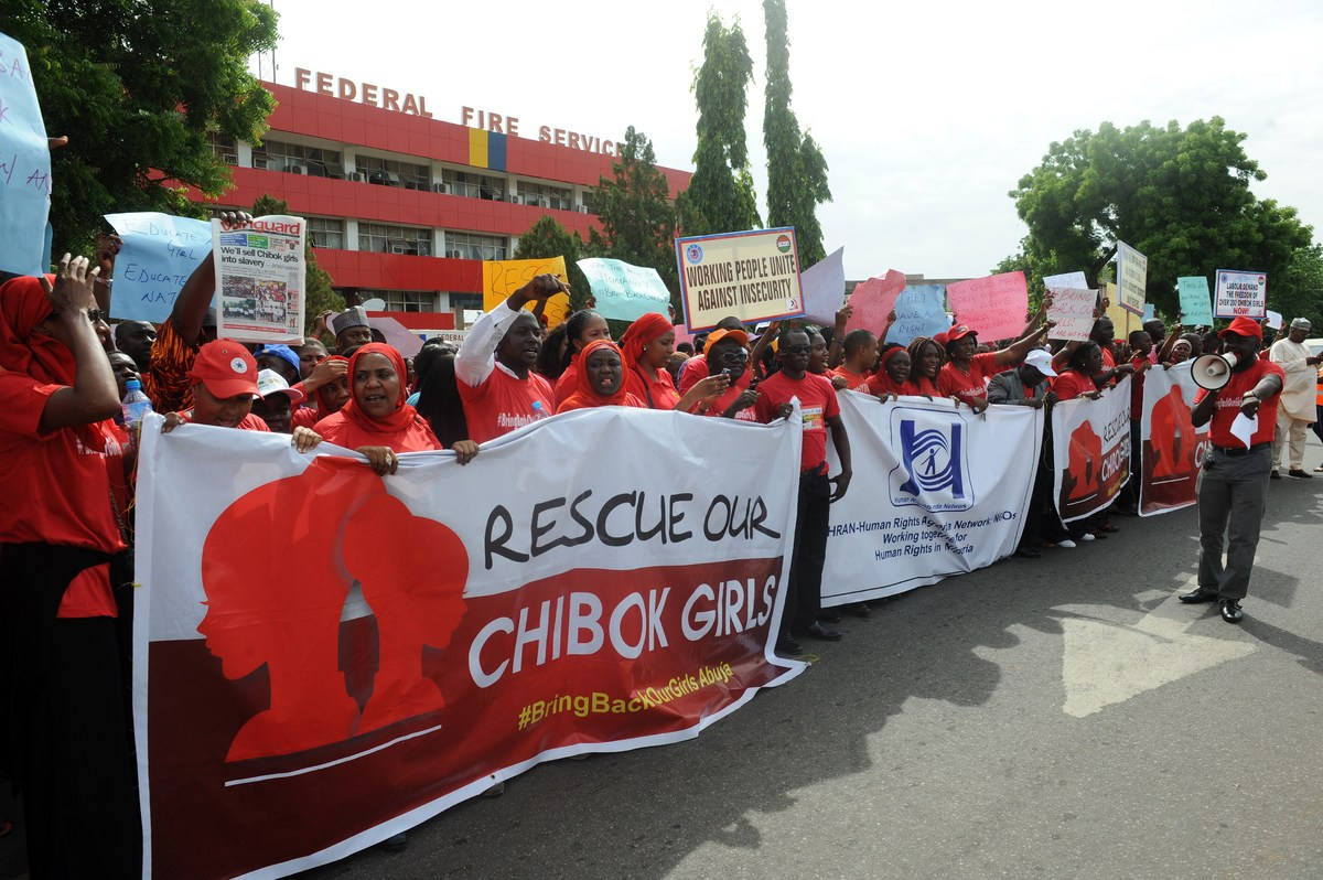 Members of civil society groups hold banners and shout slogans as they protest the abduction of Chibok school girls during a