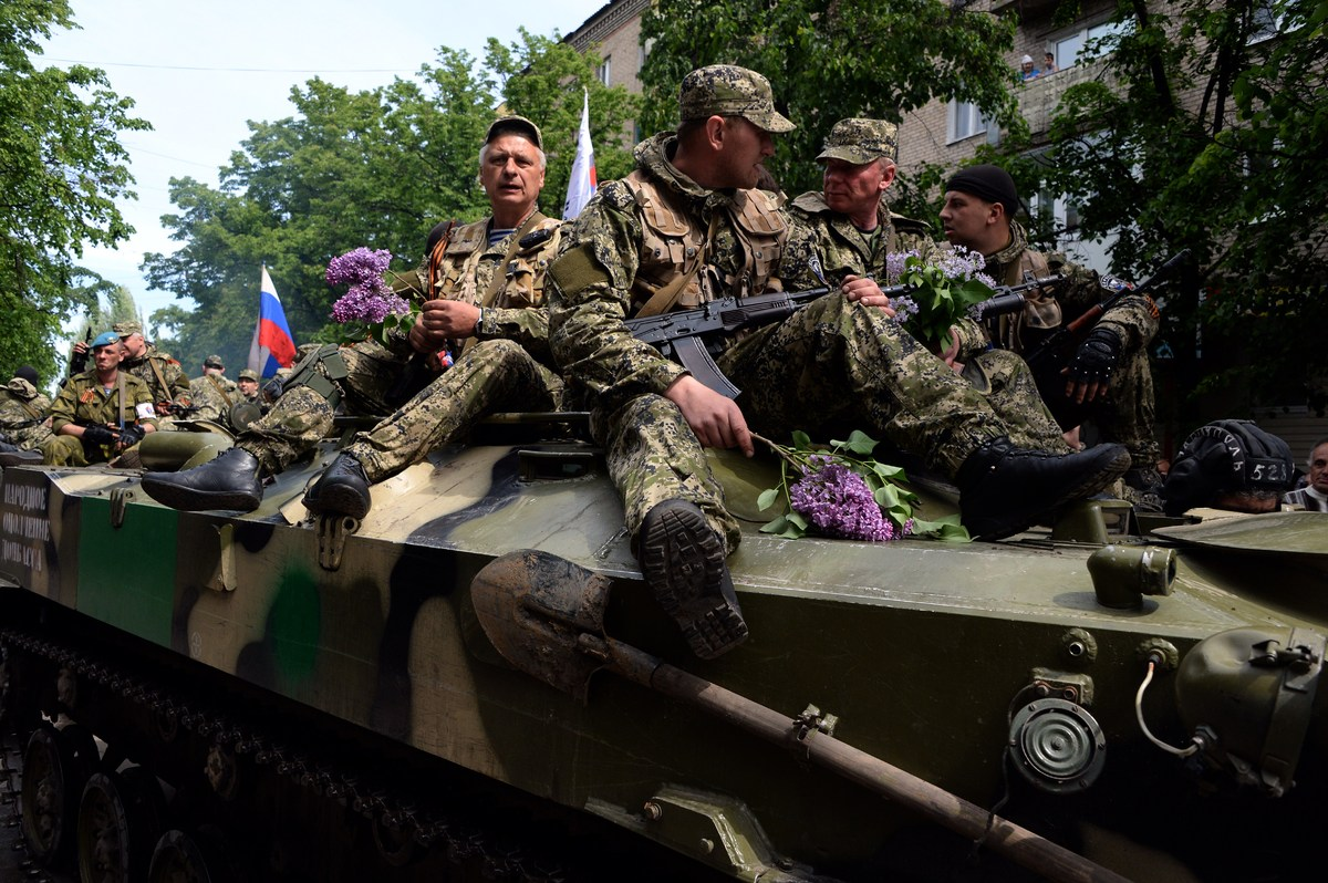 Armed pro-Russian militants part in a ceremony marking the 69 years since Soviet victory in World War II, in Slavyansk on May