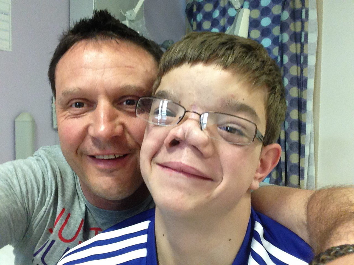 Collect photo of Staff Sergeant Wayne Ingram with Stefan Savic on a previous trip to London to repair his facial deformity. A