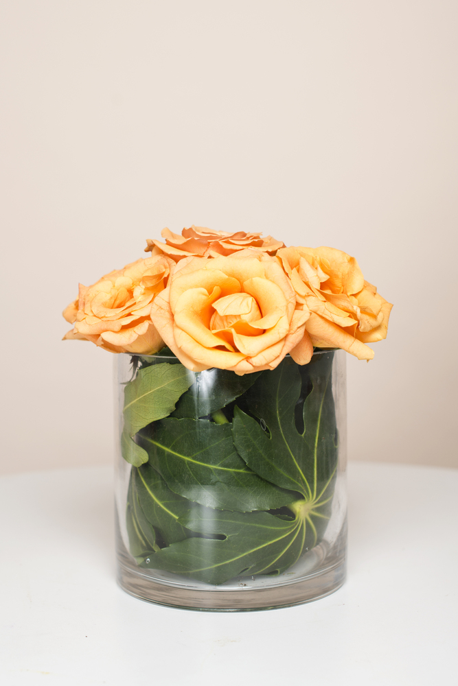 Using the greenery in new and unexpected way (like as a vase liner) gives an element of sophistication.
