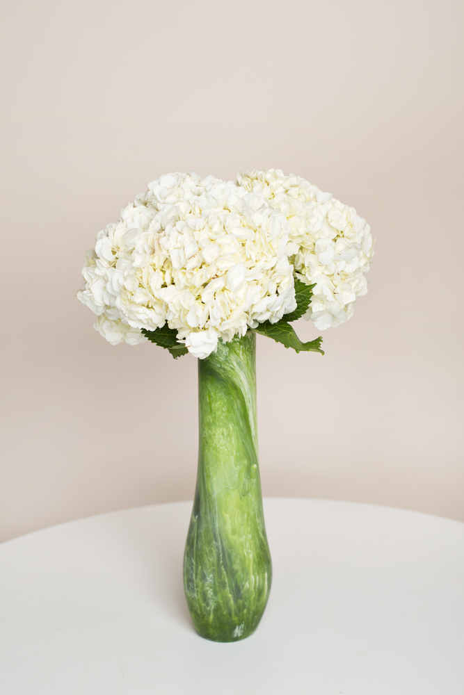 A dramatic vase makes all the difference in the world when arranging foolproof flowers like these.