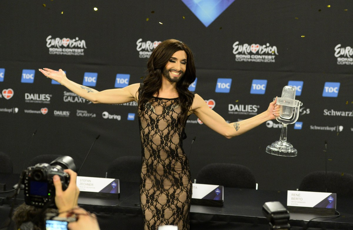Conchita Wurst representing Austria poses with the trophy after a press conference after winning the Eurovision Song Contest