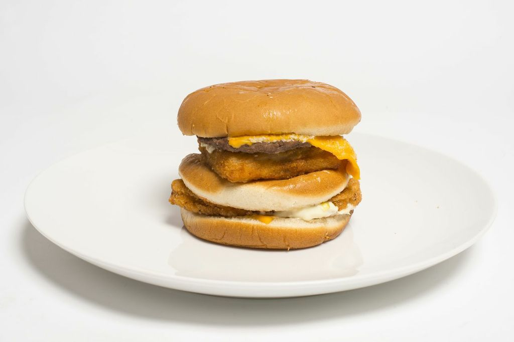 <strong>Description:</strong> This is a beef, chicken and Filet-O-Fish patty stacked in one bun. We decided to separate the c