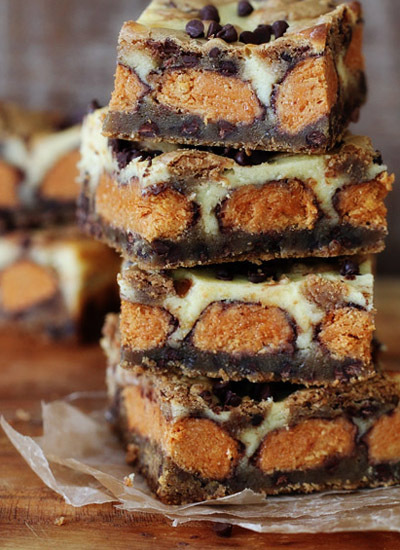 """<strong>Get the <a href=""""http://www.bakersroyale.com/bars-and-cookie-bars/butterfinger-cookie-dough-cheesecake-bars/"""">Butterf"""