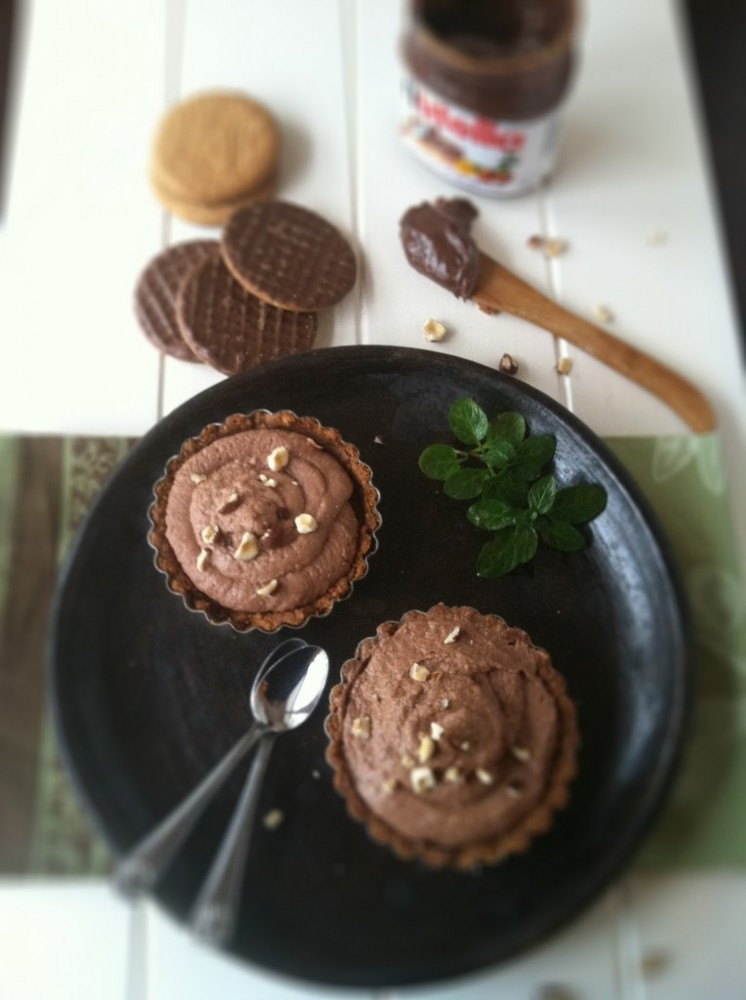"""<strong>Get the <a href=""""http://www.bellalimento.com/2012/02/05/nutella-and-mascarpone-chocolate-tarts/"""" target=""""_blank"""">Nute"""
