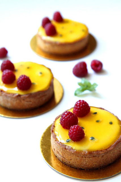 """<strong>Get the <a href=""""http://gourmetbaking.blogspot.com/2012/05/passion-fruit-and-raspberry-tart.html"""" target=""""_blank"""">Pas"""