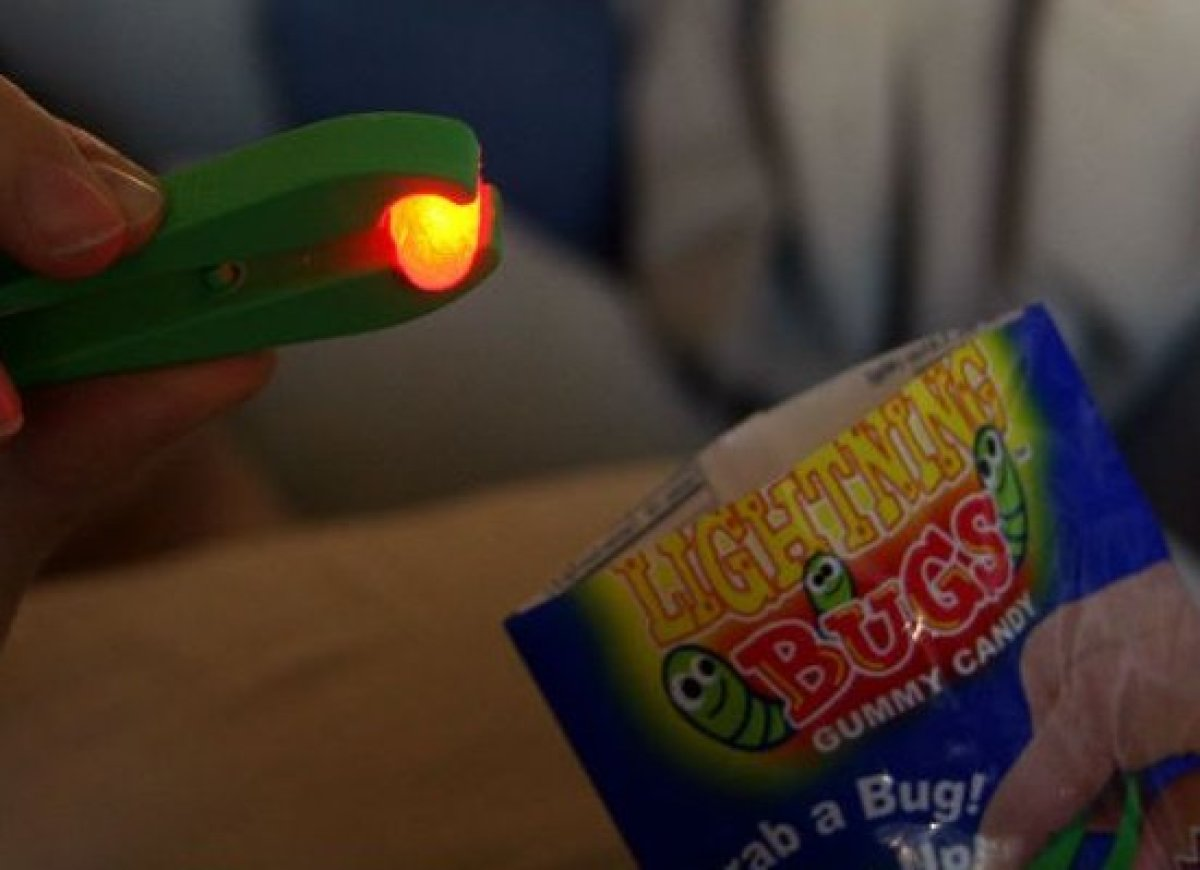 Who wouldn't like their candy to light up before they eat it? The actual gummy, in the shape of a wormy-bug-thing, is pretty