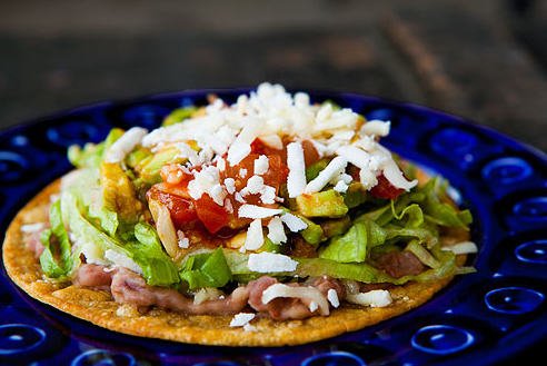 "<strong>Get the <a href=""http://www.simplyrecipes.com/recipes/mexican_tostada/"" target=""_blank"">Mexican Tostada recipe</a> by"