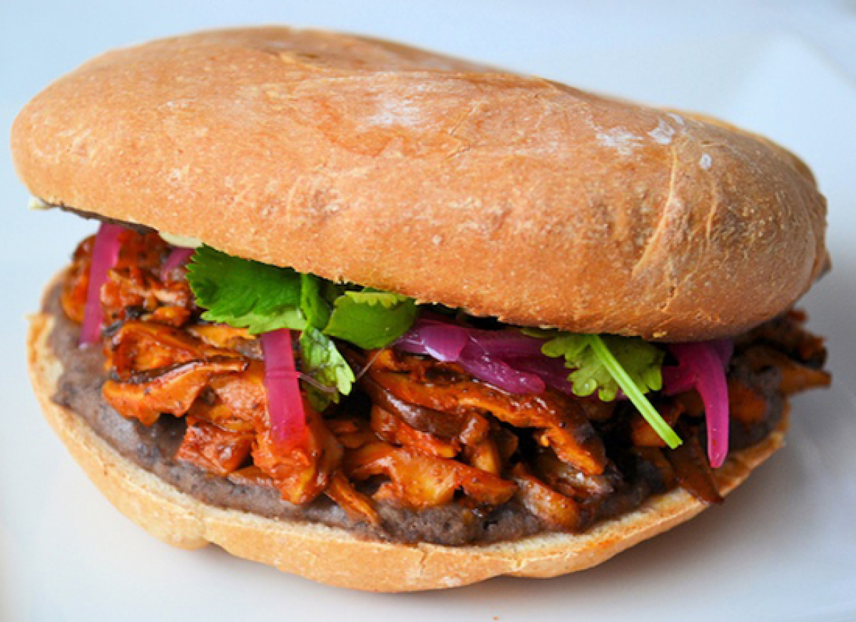 "<strong>Get the <a href=""http://www.namelymarly.com/2011/03/americas-top-10-new-sandwiches-veganized-pibil-torta-sandwich/"" t"