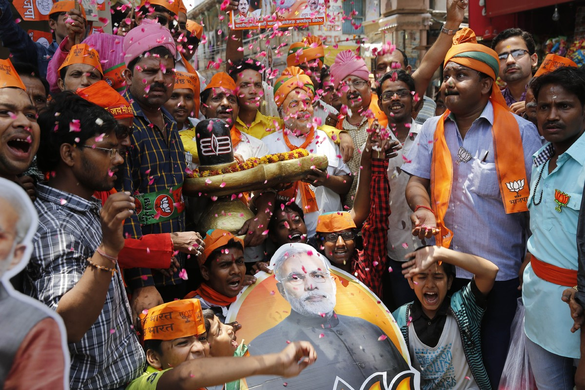 BJP supporters hold a shivling, a symbolic representation of Hindu God Shiva, during celebrations in Varanasi, May 16, 2014.