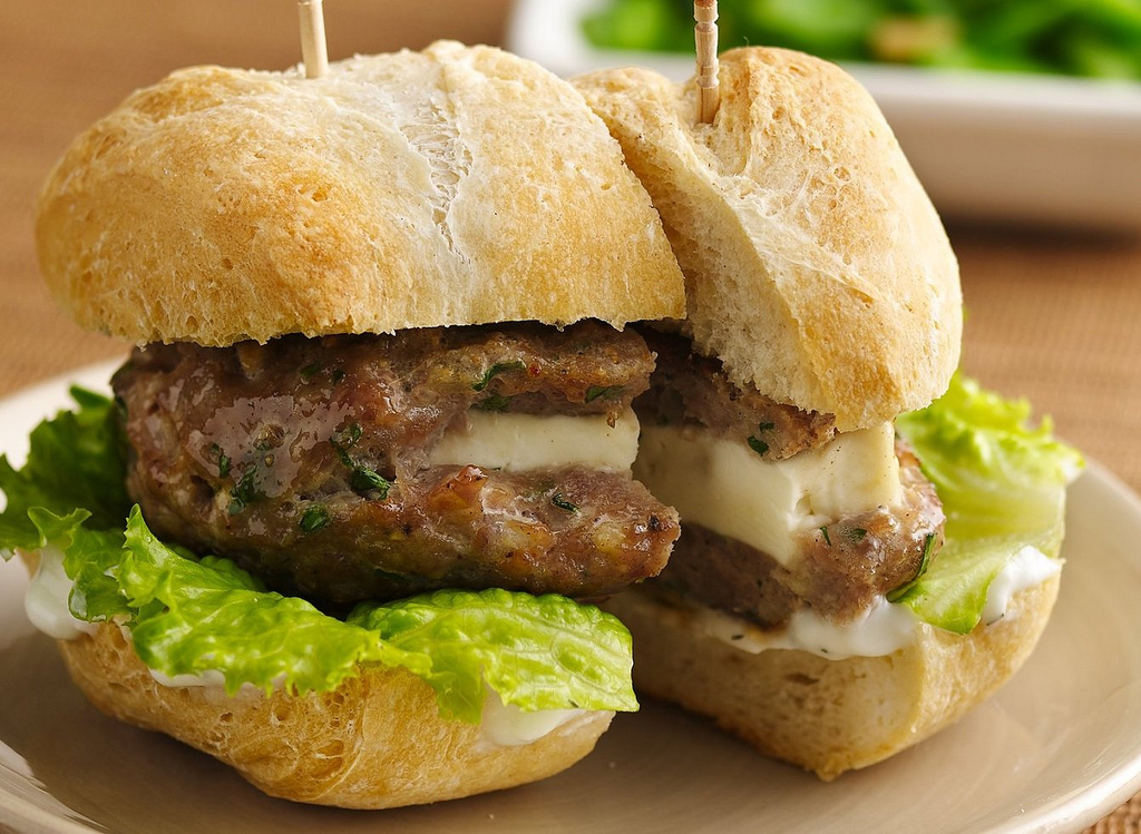 First, burgers are already perfect as they are. Adding onions, herbs or sauces to the meat is only detracting from their inhe
